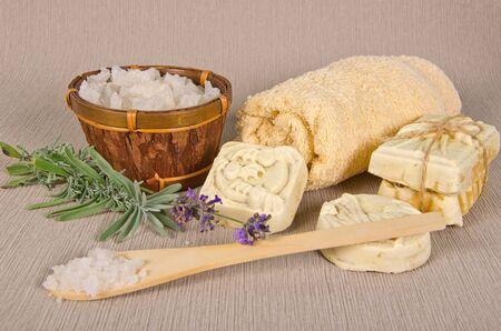 bathsalt: handmade soap and salt with lavender on grey background