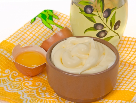 mayonnaise and its ingredients on the tablecloth Stock Photo - 17453886