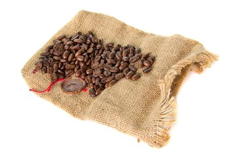 burlap bag tagged sealing wax with cofee bean photo