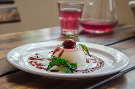 pannacotta: panna-cotta with berry on plate in restaurant
