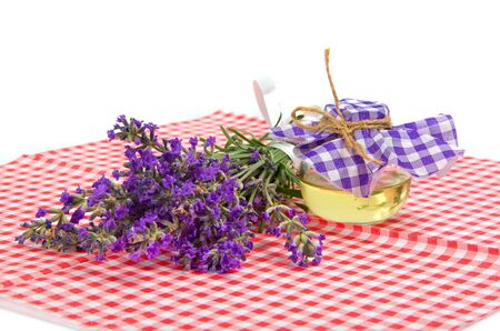 lavender and oil in bottle on checkered tablecloth photo