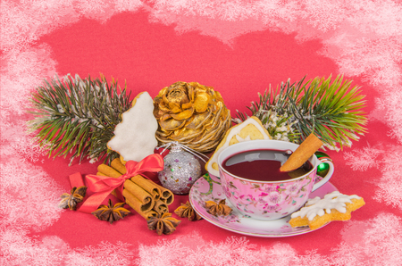 mulled wine with christmas cookies and christmas tree with  pinecone on red photo