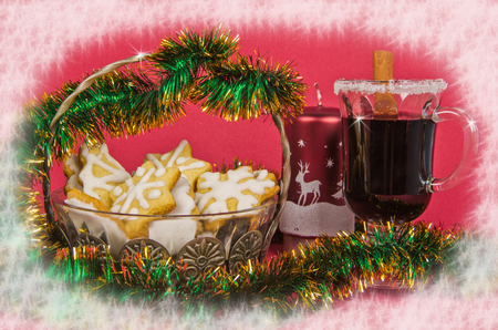 christmas cookies in vase and mulled wine with candle and tinsel on red photo