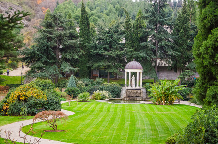 lawn and walkway leading to the gazebo in park photo