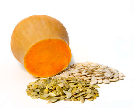 dried gourd: pumpkin seeds and sliced on white background