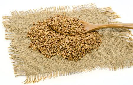 sackcloth with buckwheat and wooden spoon photo
