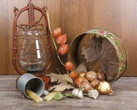 kerosene lamp: kerosene lamp and antiques on wooden table Stock Photo