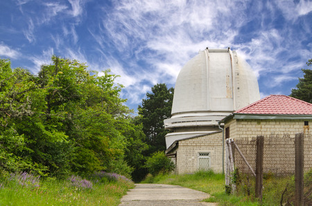 astrophysics: telescope at an astronomical observatory located in the forest area Stock Photo