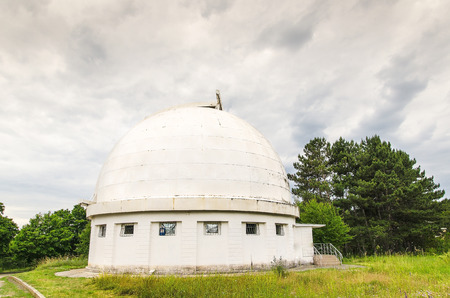 place of research: telescope at an astronomical observatory located in the forest area Editorial