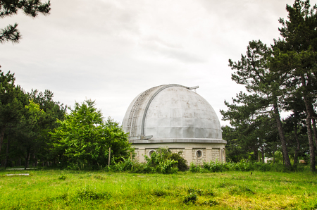 cosmology: telescope at an astronomical observatory located in the forest area Editorial