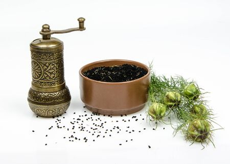 nigella seeds: cumin and mill on white background