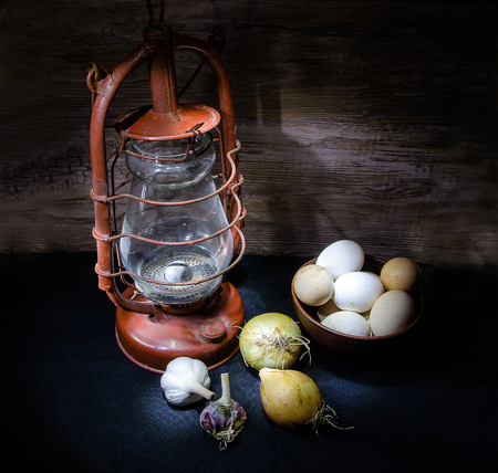 bawl: kerosene lamp and eggs with vegetables in dark