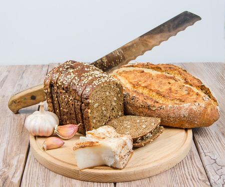 rye bread with bacon and garlic on a cutting board