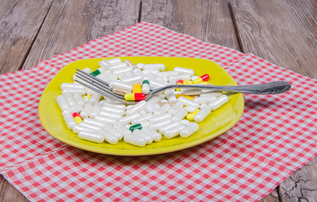 pills as dinner on a plate on napkin