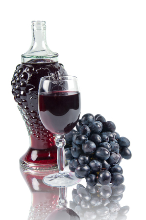 old bottle and glass with wine on white background with reflection Stock Photo