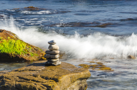 sea and stack of pebbles on stone Stock Photo