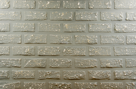 Abstract weathered texture stained old gray brick wall background Stock Photo