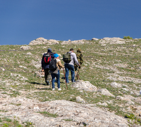 tourists are hiking to mountain on sky Stock Photo