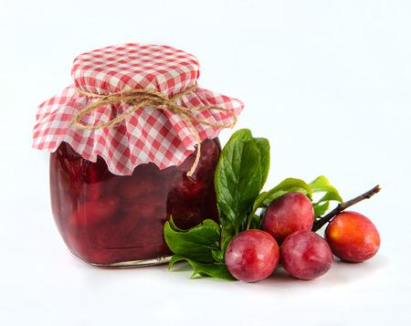 Homemade plum jam on white background