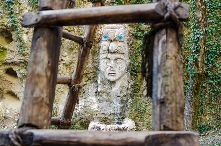 Face of Buddha on rock in jungle