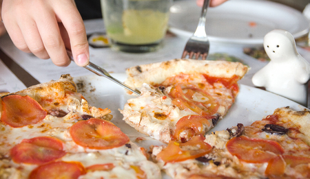 fresh baked pizza with tomato on dish Stock Photo