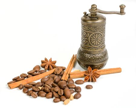 coffee bean with spices and handmill on white background