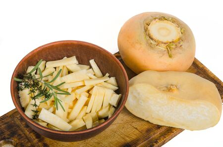 round yellow turnip and chopped turnip in bowl on wooden desk