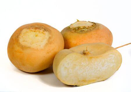 Round yellow turnips on white