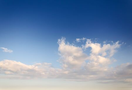 light clouds against blue sky at evening Stock Photo