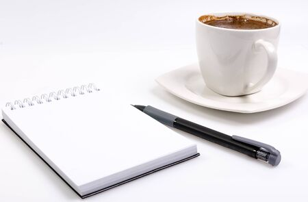 workplace with clear notebook and pencil and coffee on white background 免版税图像