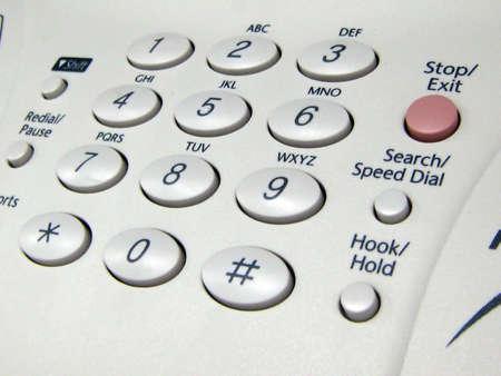 会社の fax 機のコントロール パネルの A のクローズ アップ