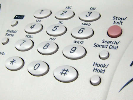 A close up of the control panel of a company fax machine