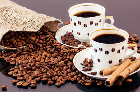 warm cup of coffee on brown background Stock Photo - 13906076