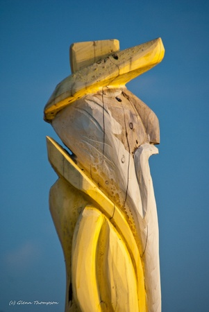 Wooden statue of old sailor standing at a dock on the West River Maryland