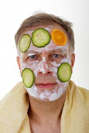 with orange and white body: hombre con la m�scara facial Foto de archivo
