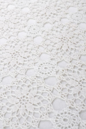 White lace tablecloth as background