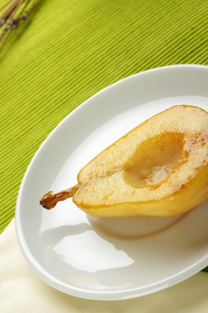 Poached pear cooked in sweet caramel
