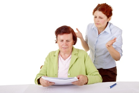Female don t know what to do  Two women and paperwork  photo