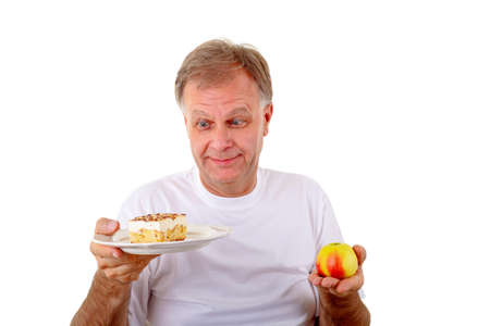 The choice-cake or apple  Stock Photo - 16883793