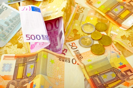 background of euro banknotes and coins photo