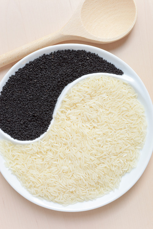nigella seeds: Rice and nigella seeds Stock Photo