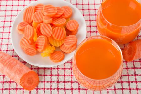 crinkle: Crinkle slices of frozen carrot and carrot juice Stock Photo