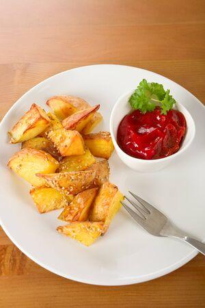 dip: Baked potato wedges with tomato dip Stock Photo