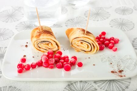 rolled: Rolled crepes with red currant.