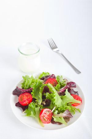 dip: Salad with tomato cucumber and  cream dip
