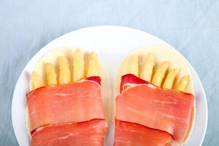 Funny food recipe: asparagus ham feet Stock Photo
