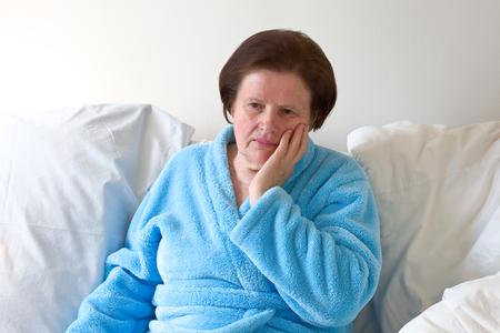 proble: Sad senior woman Stock Photo