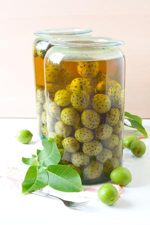 Black Walnuts Unripe Pickled Walnuts. Stock Photo