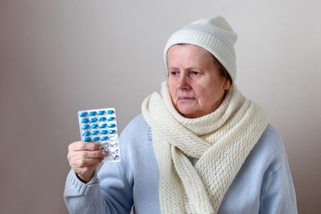 Senior woman with pills Stock fotó