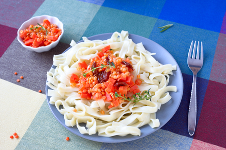 Pasta with red lentils and carrot.